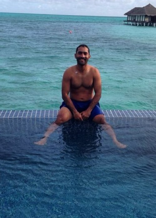 Dinesh Karthik as seen in a picture while he soaks his feet in a pool of water in June 2014