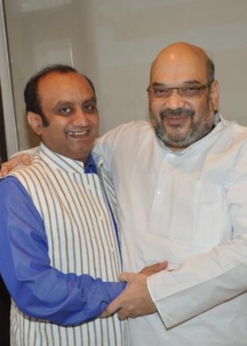 Amit Shah (Right) as seen while sharing a candid moment with politician Sudhanshu Trivedi in August 2017