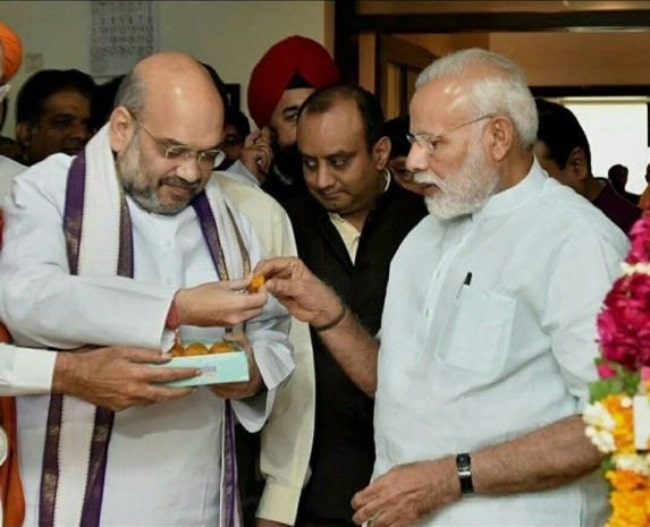 Amit Shah (Left) as seen in a picture along with Prime Minister Narendra Modi in August 2017