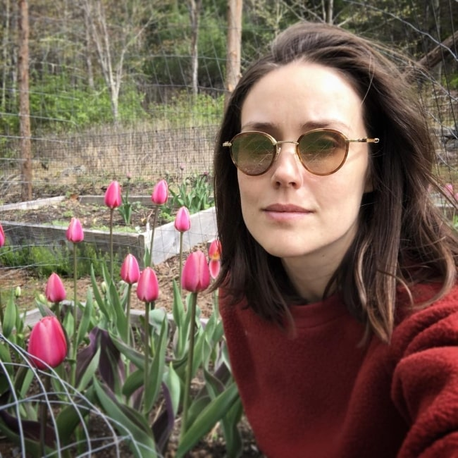 Megan Boone as seen while taking a selfie with beautiful tulips in April 2019