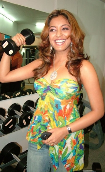 Tanushree Dutta as seen while lifting light weights during the inauguration of Power House Gym