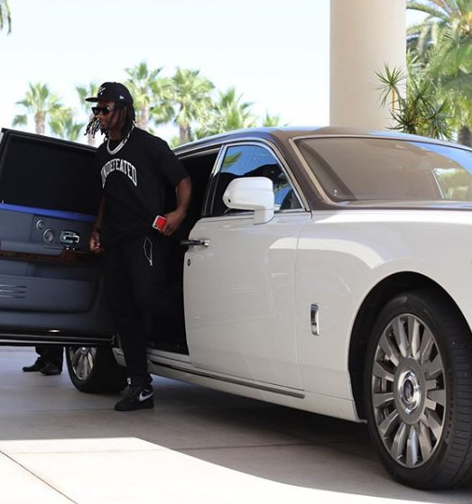 Todd Gurley coming outside from his car