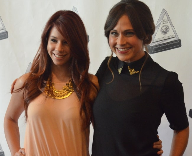 Nikki DeLoach (Right) as seen while posing for the camera alongside Jillian Rose Reed at Media Access Awards in October 2012