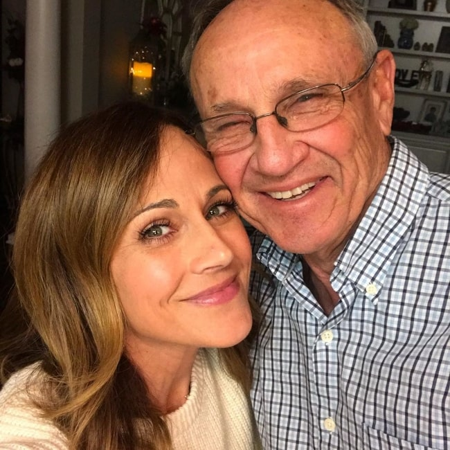 Nikki DeLoach as seen while smiling in a picture along with her father in Pierce County, Georgia, United States in June 2019