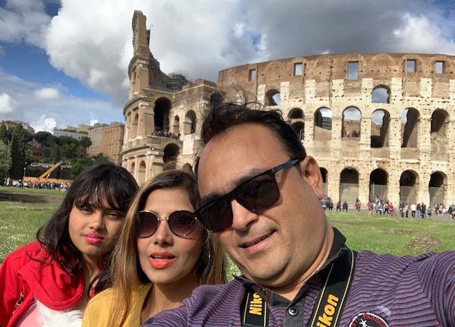 Mausumi Das Chatterjee with her husband and daughter at Colosseum in Italy in 2019