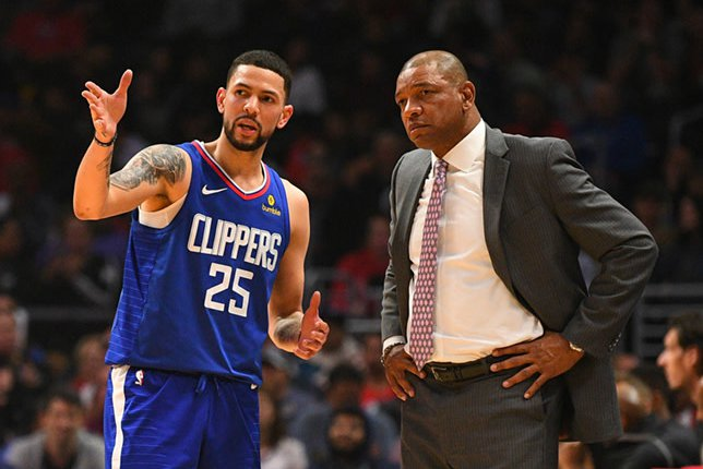 Doc Rivers with his son Austin during the game