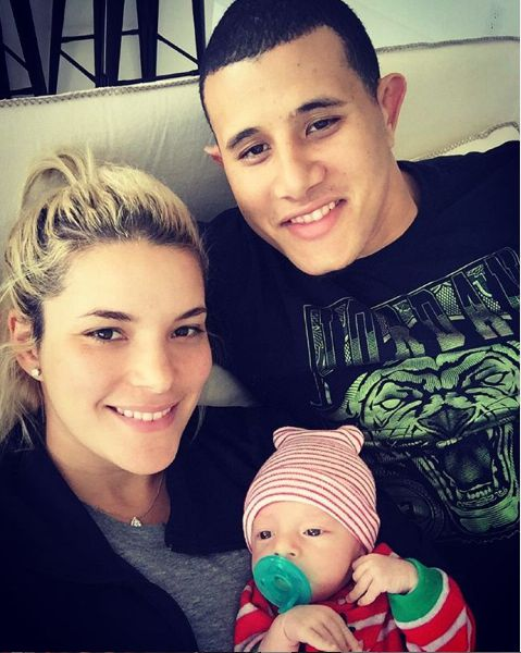 Manny Machado with his wife and son