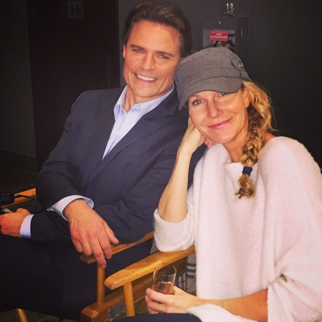 Dylan Neal as seen while posing for a picture along with his wife, Becky Southwell, in December 2014
