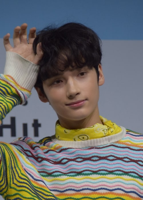 Huening Kai as seen while posing for the camera at Tomorrow X Together's debut showcase in March 2019
