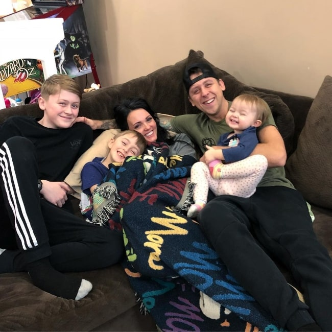 Noah Atwood (Corner Left) smiling in a picture alongside his family in March 2019