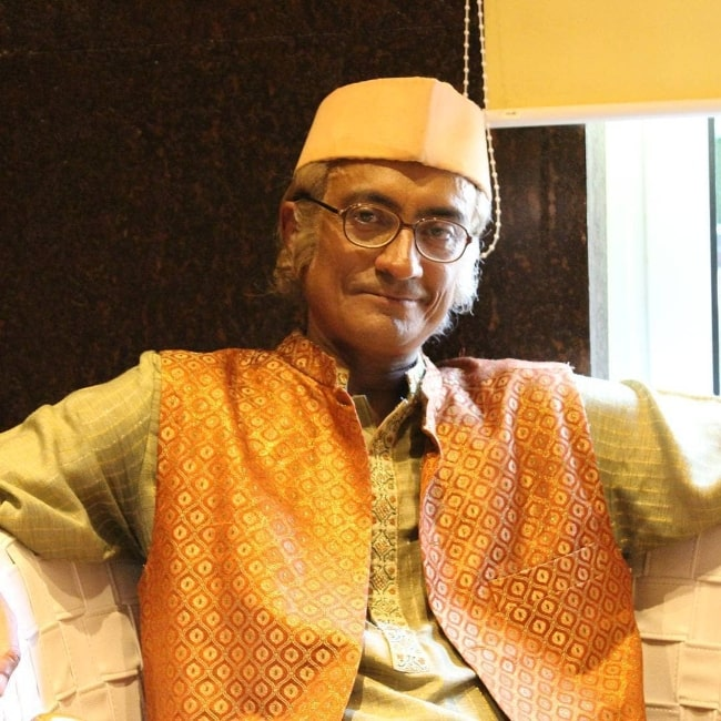 Amit Bhatt smiling for a picture while dressed as Champaklal Jayantilal Gada from 'Taarak Mehta Ka Ooltah Chashmah'