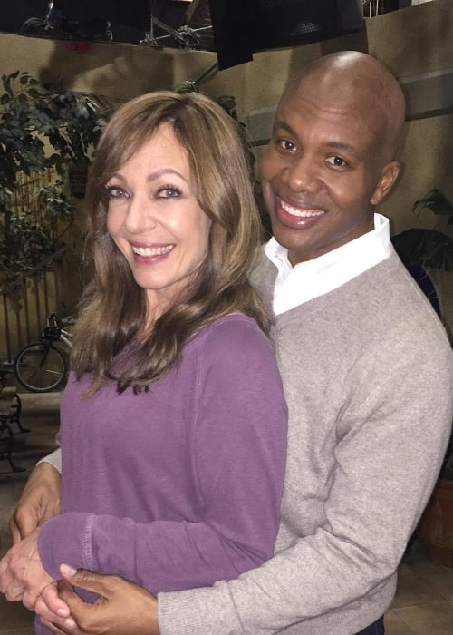 Leonard Roberts as seen while smiling in a picture alongside Allison Janney