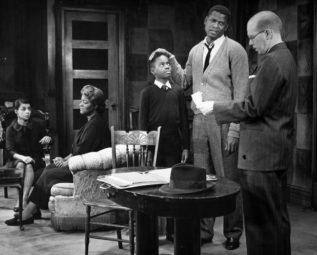 From Left to Right - Ruby Dee, Claudia McNeil, Glynn Turman, Sidney Poitier, and John Fiedler in a scene from the play 'A Raisin in the Sun'