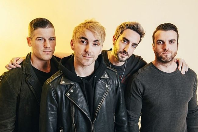 Rian Dawson (extreme right) as seen with his band members from All Time Low