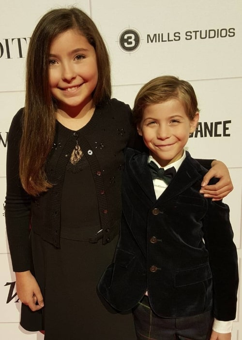 Emma Tremblay smiling for the camera alongside her brother during an event