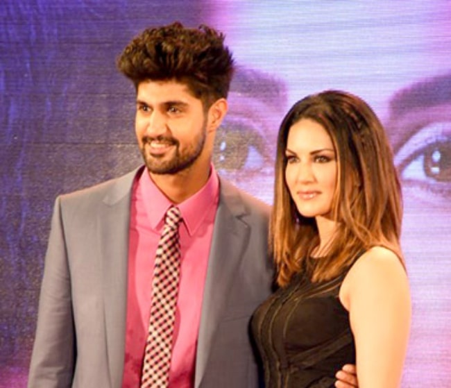 Tanuj Virwani as seen while posing for the camera alongside Sunny Leone at the trailer launch of 'One Night Stand' in June 2016
