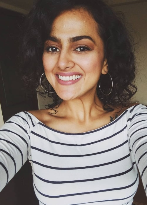 Shraddha Srinath as seen while smiling for a selfie in Koduvayur in December 2020
