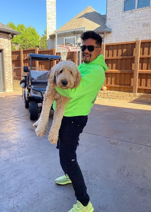 H3CZ as seen in a picture that was taken in October 2019, with one of his dogs