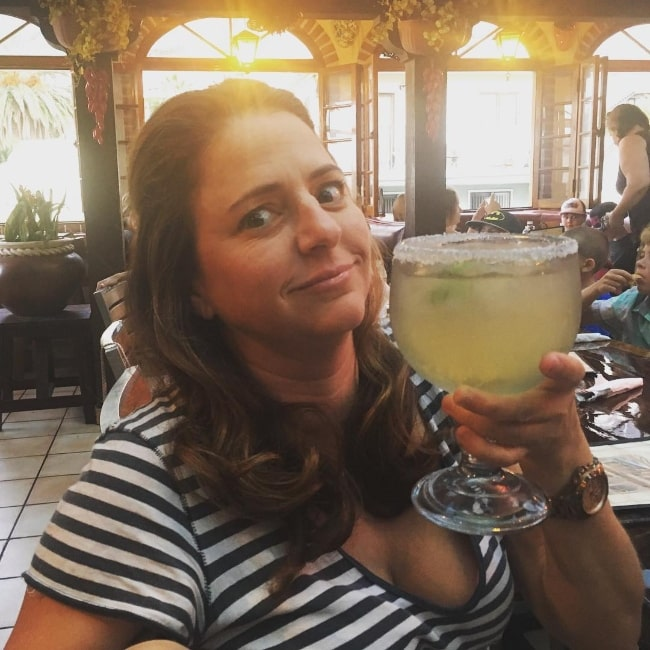 Annie Mumolo as seen while posing for a picture with her drink in July 2016
