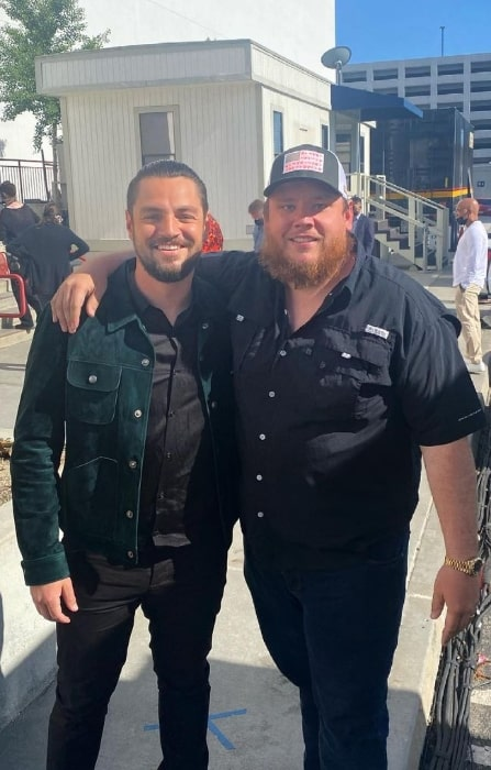 Chayce Beckham (Left) as seen while smiling for a picture alongside Luke Combs in May 2021