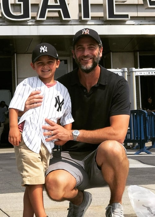 Andrew Form smiling for a picture alongside his son Julian in an Instagram post in September 2020