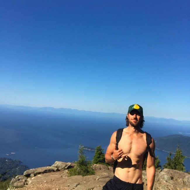 Adam Demos as seen while posing shirtless for a picture in Vancouver, British Columbia in 2020