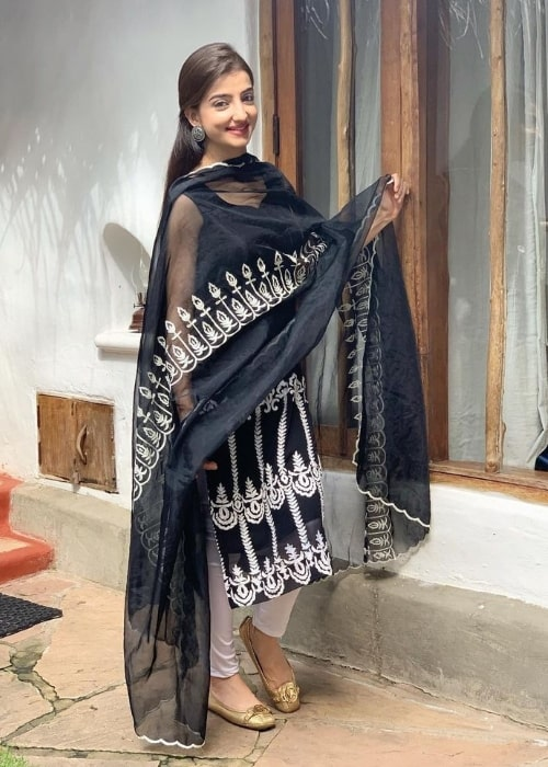 Loveleen Kaur Sasan as seen while smiling for the camera in December 2020