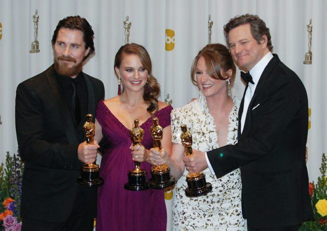 (From l to r) Christian Bale, Natalie Portman, Melissa Leo, and Colin Firth posing with their Oscars in 2011