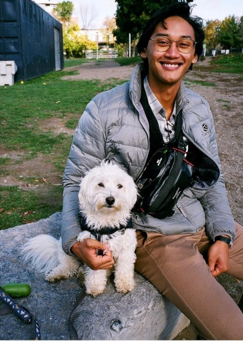 Josh Dela Cruz and his dog as seen in a picture that was taken in November 2020
