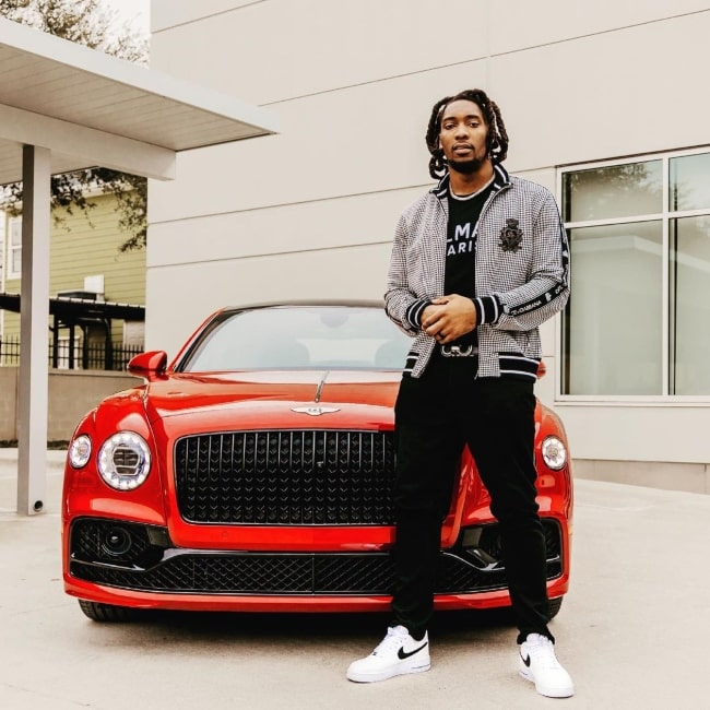 DeMarcus Lawrence as seen in a picture that was taken in front of a Bentley in June 2021