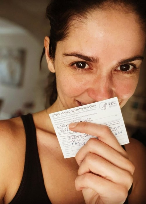 Carla Ossa as seen in a selfie that was taken with her vaccination ceritificate in May 2021