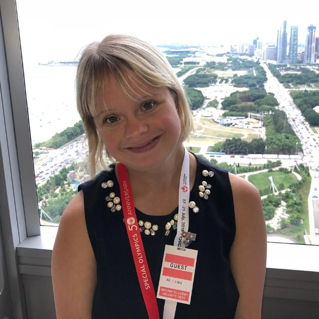 Lauren Potter smiling for a picture in Chicago, Illinois in July 2018