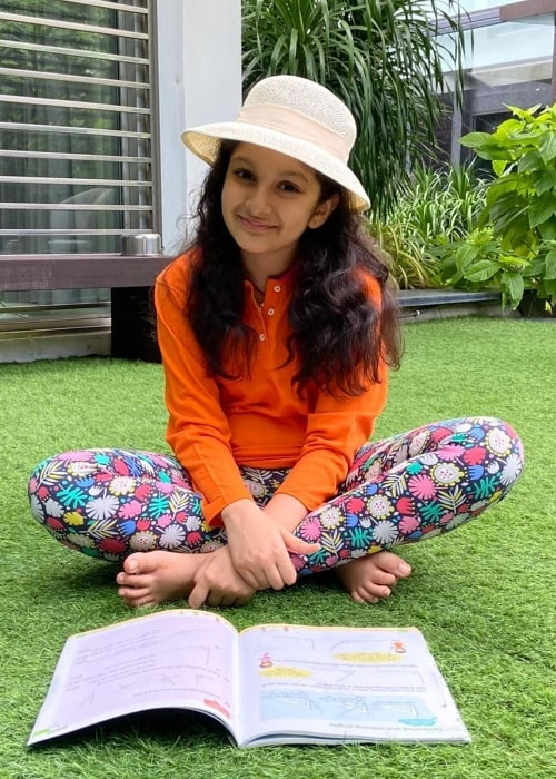 Sitara Ghattamaneni as seen while smiling for a picture in June 2021
