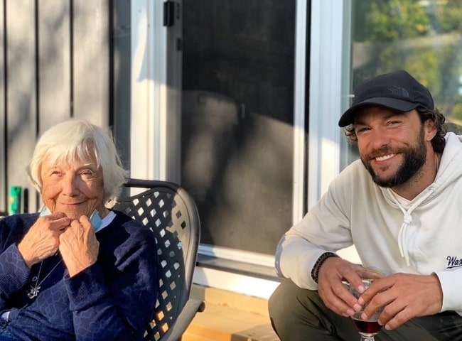 Kyle Schmid smiling for a picture with his grandmother in February 2021