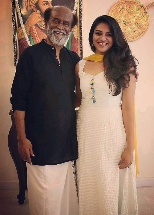 Indhuja Ravichandran posing for a picture with Rajinikanth