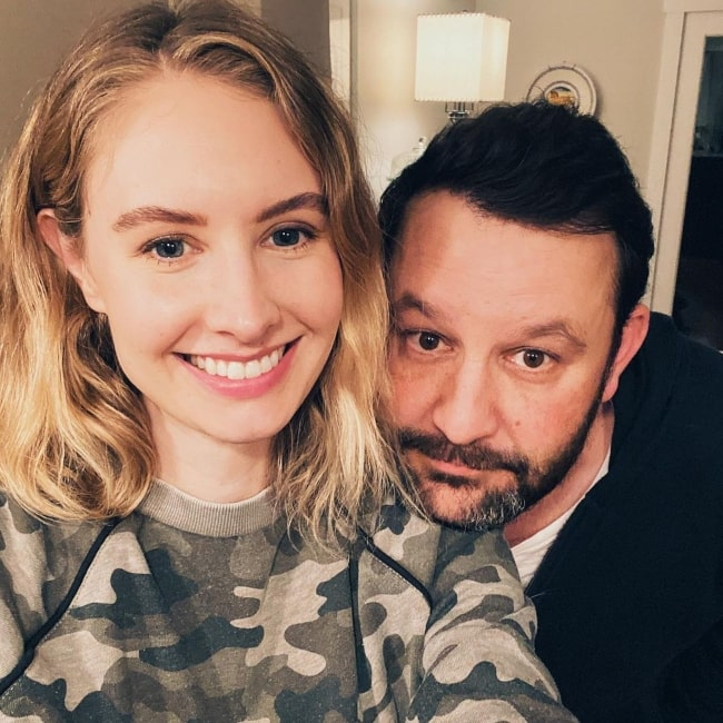 Caitlin Thompson with her husband in January 2020 wishing everyone a happy new year