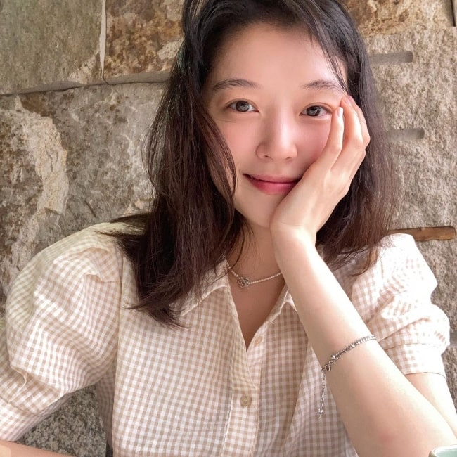 Jo Woo-ri smiling for a picture in August 2021