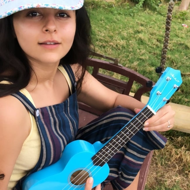 Yesha Rughani in June 2020 having a beautiful time playing the ukulele