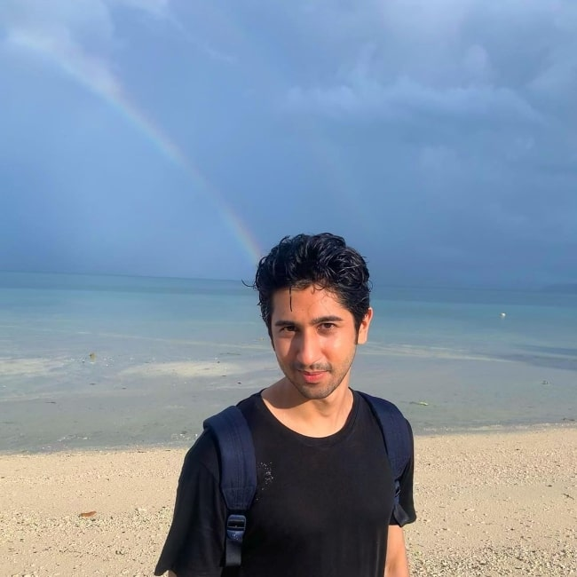 Vihaan Samat as seen while posing for a picture with a rainbow in the background