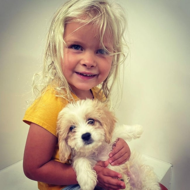 Janae Johnston as seen in a picture that was taken with a puppy in July 2021