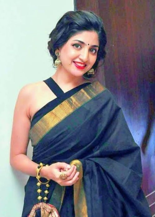 Poonam Kaur as seen while smiling for a picture